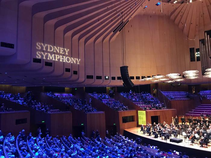 Abridged version of the new logo, projected onto the wall of the Concert Hall of the Sydney Opera House.