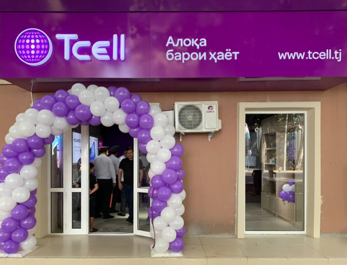 "Shop front with slogan and URL in Omnes. Алоқа барои ҳаёт is Tajik for ""Connection to life""."