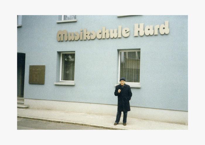 Othmar Motter in front of the building (undated), before the tree was planted that now obscures the sign. Image courtesy of Triest Verlag.