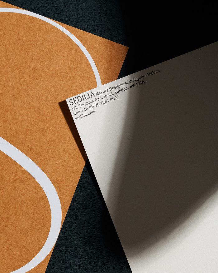 The stationery is printed on a range of beautiful Japanese papers that echo the materials and colours used in the furniture collection. Type is minimal, tucked tightly away into corners.